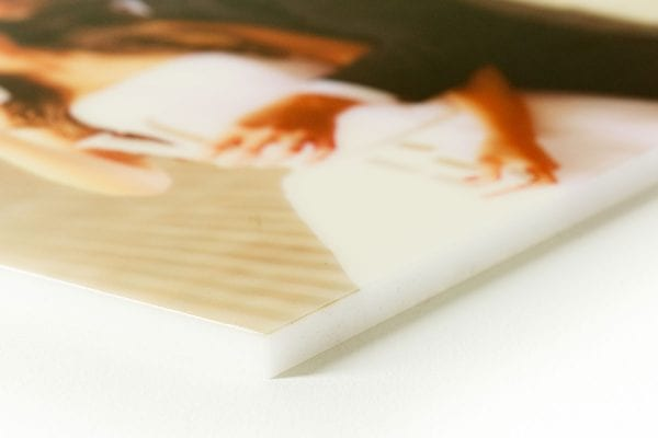 Side/lower view of a photo on white acrylic